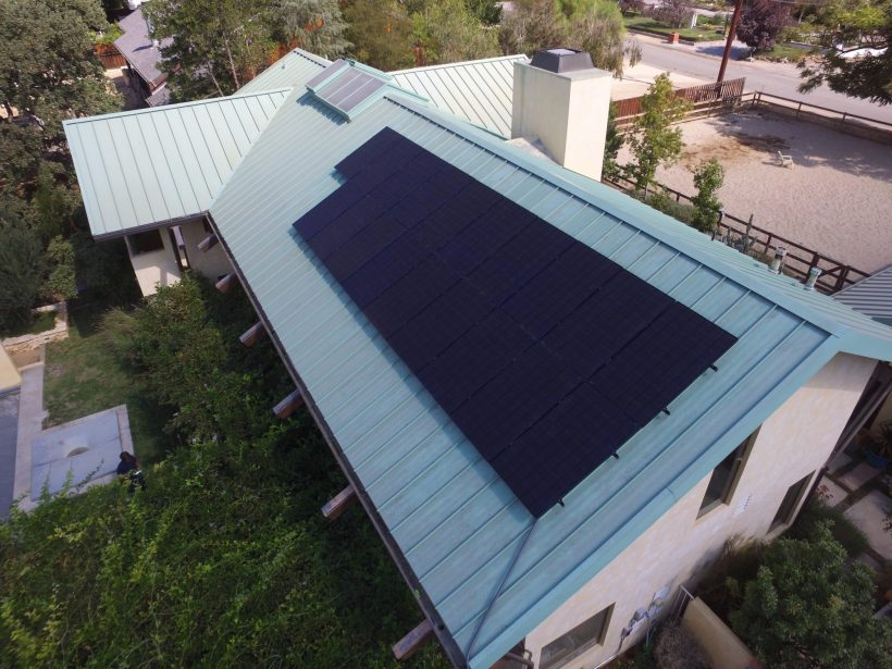 5.8 KW ROOFTOP SOLAR SYSTEM MOUNTED ON STANDING SEAMS ROOF